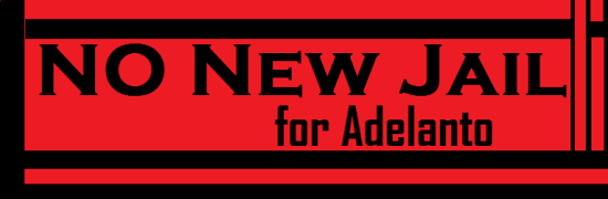 'No new jail for Adelanto' banner