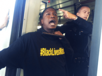 """BART police, from the force that murdered Oscar Grant, prompting the years-long resistance that inspires Ferguson, seemed perplexed when the all-Black Blackout Collective risked their lives on so-called Black Friday to say, """"Black lives matter."""""""