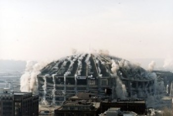 The Seattle Kingdome, brought down in March 2000, is the largest building ever destroyed by implosion. Fortunately, it was located in a non-residential area. – Wikimedia