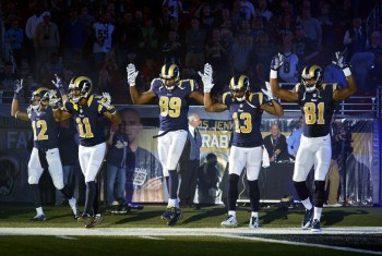"St. Louis Rams players Stedman Bailey, Tavon Austin, Jared Cook, Chris Givens and Kenny Britt took the field signaling ""Hands up, don't shoot"" to protest the police murder of Michael Brown at the start of the Oakland Raiders game on Sunday, Nov. 30. – Photo: Jeff Curry, USA Today Sports"