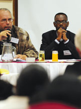 Congolese mining researcher Dr. Jean Didier Losango, shown here with David van Wyk at a mining conference, spoke to KPFA via Skype from Johannesburg, South Africa.