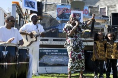 On Geronimo Day, on July 17, 2011, in Bobby Hutton Park in West Oakland, Kujichagulia sets spirits soaring, backed by her band and her little granddaughters, Xion and Saije. – Photo: Malaika Kambon