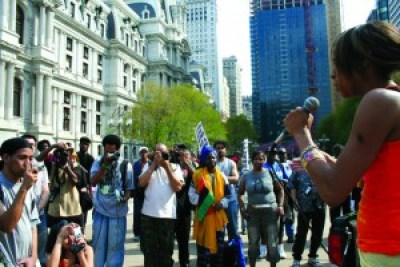 Goldii raps at a rally for Mumia on April 19, 2008. Her lyrical prowess helped draw the press, bringing him more supporters. – Photo: JR Valrey, Block Report