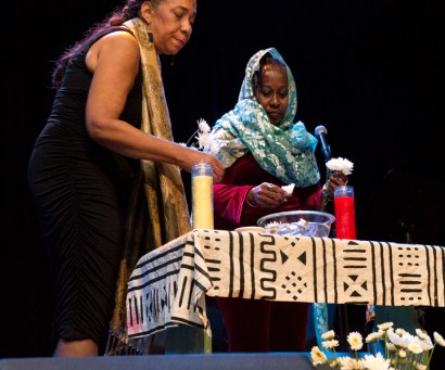 """The Daughters of Yam, devorah major and Opal Palmer Adisa, float flowers in libation """"for those who are past as well as for those who are meeting them and have yet to be born."""" – Photo: Malaika Kambon"""