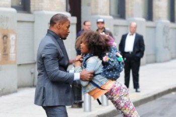 """Stars of the new """"Annie"""" movie, Jamie Foxx and Quvenzhané Wallis, practice a scene in which they slam into each other – and the young actress falls to the ground – during a film shoot on the streets of New York. – Photo: Raymond Hall, FilmMagic"""