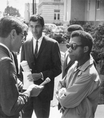 A journalist interviews Howard Zinn and James Baldwin on Freedom Day in October 1963.