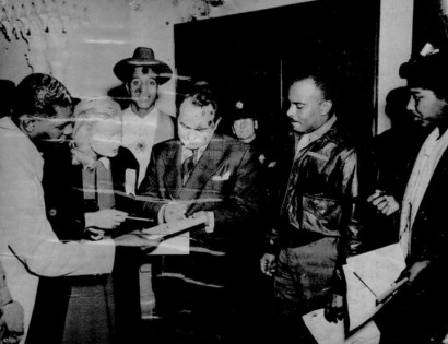 "Edward G. Robinson signs autographs at Leola King's Blue Mirror on Fillmore. Asked why a web search finds almost no photos of Mrs. King or her businesses, Lance Burton says: ""Most of Mrs. King's mementos were destroyed by the Redevelopment Agency, both at her house and at the Bird Cage, where she also had items from the Blue Mirror. They were brutal, as you know, about shutting her down. Then, what they did keep to archive was virtually ransacked at the Redevelopment offices. I spent a month going through boxes at the SFR and found nothing. I have a few pix from the club but terrible quality – water stained, blotched  and low quality."" This is one of them."