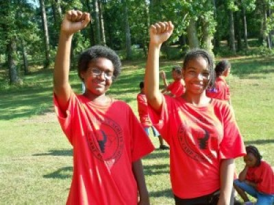 "These youngsters at Camp Pumziko in Pine Mountain, Georgia, a camp sponsored by the respected Malcolm X Grassroots Movement, say, ""We are New Afrikans and we are a nation. We will be free. Toward that end, MXGM will work to honor the legacy of our ancestors, for our own progress and for future generations."""