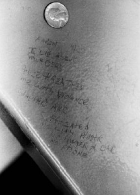"""As Aaron Patterson was being tortured by Lt. Jon Burge's goons, he recanted his """"confession"""" with this statement that he scratched into the paint on the underside of the table. Aaron is one of 20 survivors still in prison. The vast majority have received no compensation or counseling."""