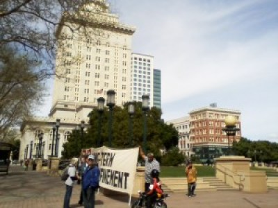 Activists Annie Kane and Jerry Elster check out the window slits atop Oakland City Hall. A city worker told them that behind the slits are SHU-like cells that are no longer used. – Photo: Kim Rohrbach