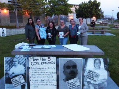 In San Diego, protesters displayed posters of prisoners tortured every day for decades in solitary confinement. With so many men in prison, women must hold up more than half the sky in the struggle to free them.