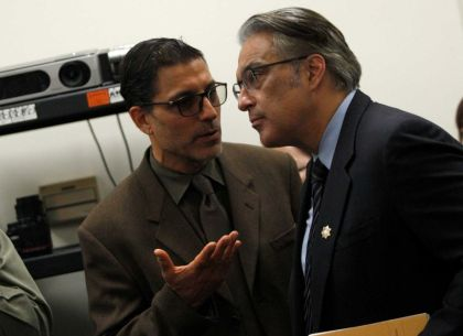 S.F. Prisoner Legal Services Directing Attorney Nicholas Gregoratos confers with Sheriff Ross Mirkarimi during a news conference Thursday, March 26, in the Public Defender's Office about sheriff deputies staging gladiator fights between prisoners for deputies' entertainment and gambling. – Photo: Santiago Mejia, SF Chronicle