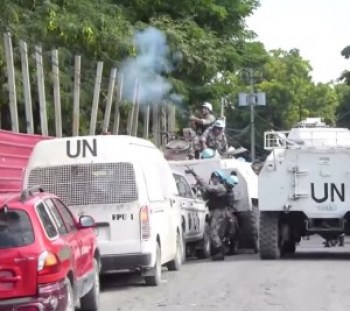 "The U.N. ""peacekeepers"" try in vain to discourage the protesters using tear gas and live ammunition."