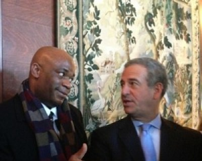 Eric Kamba meets with Russ Feingold, former U.S. envoy to the African Great Lakes Region, in January 2014.