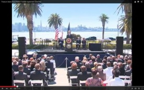 At the 2010 ceremony on Treasure Island, where Congresswoman Pelosi, then-Mayor Newsom and Navy Secretary Mabus signed the island from the Navy back to San Francisco, Willie Brown sits in the audience. He's the only one wearing a hat. – Video: Gavin Newsom