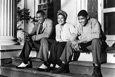 Paul Robeson Jr., at age 14, sits with his parents, Paul Sr. and Eslanda, on the front porch in Enfield, Conn., in 1941. – Photo: Frank Bauman, Look Magazine, via Schomburg Center for Research in Black Culture, New York Public Library