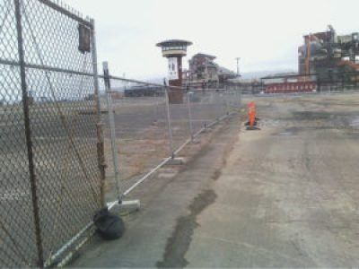 A lonely tower stands in the rubble of the Candlestick Stadium parking lot. – Photo: Rochelle Metcalfe