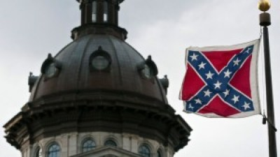 Though removed a few years ago from the flagpole on the capitol dome in Columbia, South Carolina, after a deal was cut with the NAACP, the Confederate battle flag still flies nearby on the grounds.