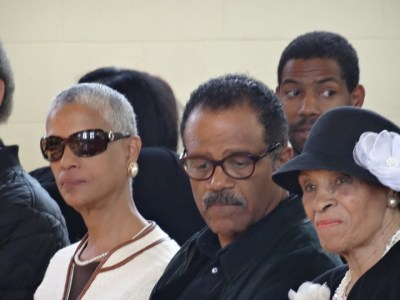 Michael Lange's sister Jana, brother Ted and mother Jerri Lange reflect at his funeral May 30 in St. Columba Catholic Church, Emeryville. – Photo: Wanda Sabir