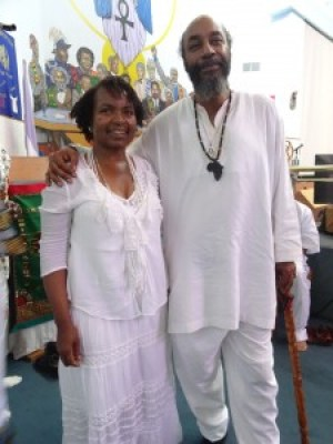 Wanda poses with President General Senhor of the UNIA at the Annual Libation for African Ancestors. – Photo: Wanda Sabir