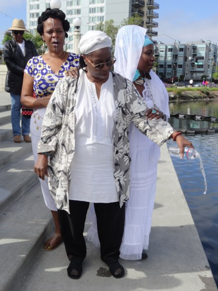Mama Geri Abrams pours a libation at the Ninth Annual Libation for the Ancestors at Lake Merritt in Oakland June 13. – Photo: Wanda Sabir
