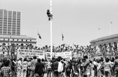 April 15, 1984: Spartacist League supporter Richard Bradley climbs the flagpole at the San Francisco Civic Center to rip down the Confederate battle flag.