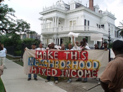 "In 2006, members of the Survivor Village tent city outside the St. Bernard public housing complex took their struggle to affluent Uptown New Orleans' St. Charles Avenue near Tulane University. They wanted to return to their own homes, which were damaged very little or not at all by the storm, not be forced into the fake substitute of ""mixed-income housing."" But instead, 4,000 safe and sound homes in public housing complexes were all demolished. – Photo: Indymedia"
