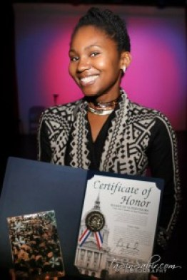 Photojournalist and art photographer TaSin Sabir displays her awards at Black Media Appreciation Night 2014. – Photo: TaSin Sabir