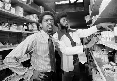Bobby Seale and a doctor in a Black Panther Party medical clinic