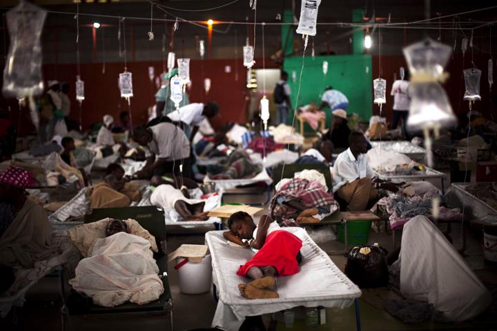 https://i1.wp.com/sfbayview.com/wp-content/uploads/2015/08/Cholera-victims-in-converted-sports-center-Cap-Haitien-2010-by-Emilio-Morenatti-AP-web.jpg