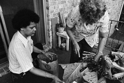 Georgia state Sen. Julian Bond prepares collard greens with his mother at home in Atlanta in 1975. – Photo: Boyd Lewis