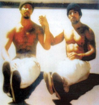 Sitting in the sunshine on the San Quentin yard in 1976 are Khatari Gaulden and Hugo Pinell. – Photo courtesy Kiilu Nyasha