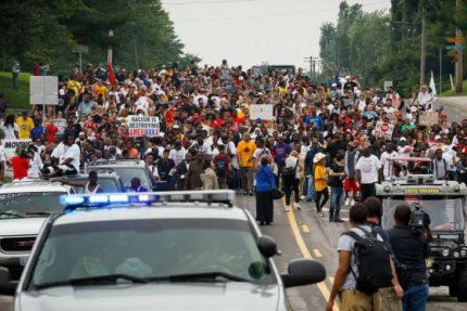 Crowds mass in the streets of Ferguson to remember Michael Brown and all victims of police, 706 so far in 2015 alone, according to Voice of Detroit.
