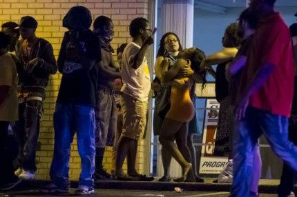A young woman collapses upon learning Tyrone Harris Jr. had been shot.