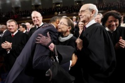 President Obama embraces Justice Ruth Bader Ginsburg on Capitol Hill in Washington, Tuesday, Jan. 25, 2011, prior to delivering his State of the Union address, as Chief Justice John Roberts and Justices Anthony Kennedy, Stephen Breyer and Sonia Sotomayor look on. – Photo: Pablo Martinez Monsivais, UPI