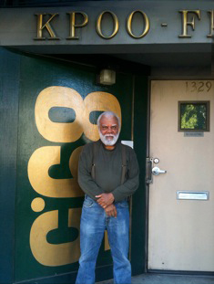 Terry Collins stands at the door to KPOO, which owns its building on Divisadero in the historically Black Fillmore District. – Photo: SFSU