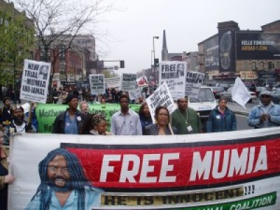 Supporters march for Mumia in Harlem on April 23, 2005.