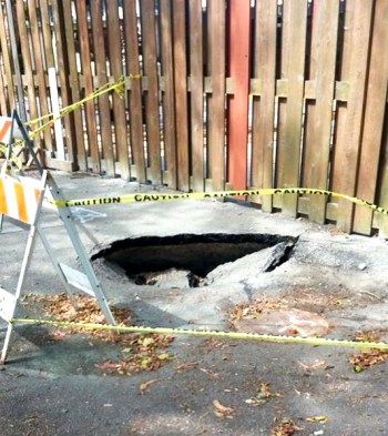 This sinkhole behind Starburst Barracks next to the Job Corps fence on Treasure Island formed after the May 28-29, 2015, vibro-compaction tests.