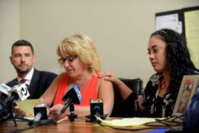 Laurie Banks, left, mother of plaintiff Daniel Banks, is comforted by Karina Arango Lopez, sister of Jesus Arango Lopez, while Banks reads a letter from her son describing how he, Lopez and a total of 20 prisoners were beaten by guards at Sonoma County Jail, during a press conference at the law office of Isaak Schwaiger, far left, in Santa Rosa, on Tuesday, Oct. 6, 2015. – Photo: Alvin Jornada, special to the SF Chronicle