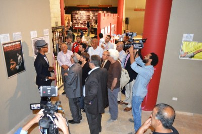Greg Thomas leads a tour of the exhibit, attended by former political prisoners Mahmoud Jiddeh and Yousef Odeh as well as Sahar Francis, director of Addameer, and Watan al-Qasim, son of Samih al-Qasim, among others.