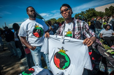 Vendors were plentiful and popular with the crowd. They say they came to feel the unity and be a part of history as much as for the profits. – Photo: Urban News Service