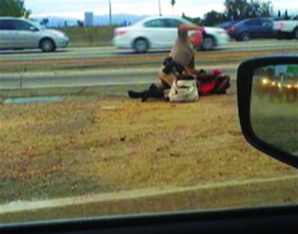 This picture was taken by another driver of a CHP officer beating Marlene Pinnock at the side of Highway 10 in Los Angeles on July 1, 2014.