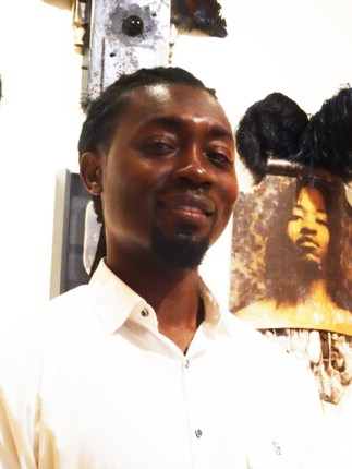 "Bryan Keith Thomas' new work, ""I'll Fly Away,"" honors African ancestors. It's in the Oakland Museum's Dia de los Muertos exhibit. – Photo: Wanda Sabir"
