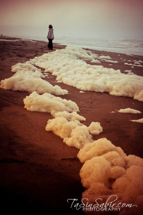 The foam from the waves was really thick on the shore. Several times during the ceremony the tide actually entered the circle and wet our feet. This was a first. – Photo: TaSin Sabir