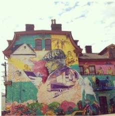 Dr. Ayodele Nzinga chooses this mural-covered house to illustrate her poem.