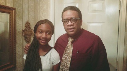 A teacher tried to humiliate student Tiara Brown, who responded with a powerful poem. She poses with her grandfather, Carlton Stimpson, who alerted his Facebook friends.