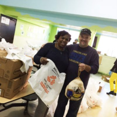 Gwendolyn Westbrook, chief executive officer of United Council of Human Services, and former Morongo Tribal Council Member Tom Linton with some of the 200 turkeys donated by the Southern California tribe to the organization. There will be plenty for everyone at Mother Brown's Kitchen this Thanksgiving at 2111 Jennings St. in Hunters Point.