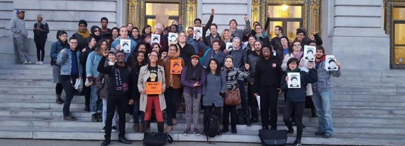 Members of the No New SF Jail Coalition celebrate victory on the steps of City Hall Dec. 15.