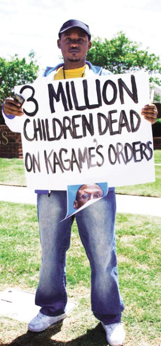 When Kagame arrived to speak at Oklahoma Christian University on April 30, 2010, he was met by protesters, including Rwandan American Claude Gatebuke. – Photo: Kendall Brown