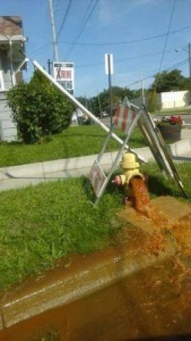 Flint's dirty water gushes from a fire hydrant.